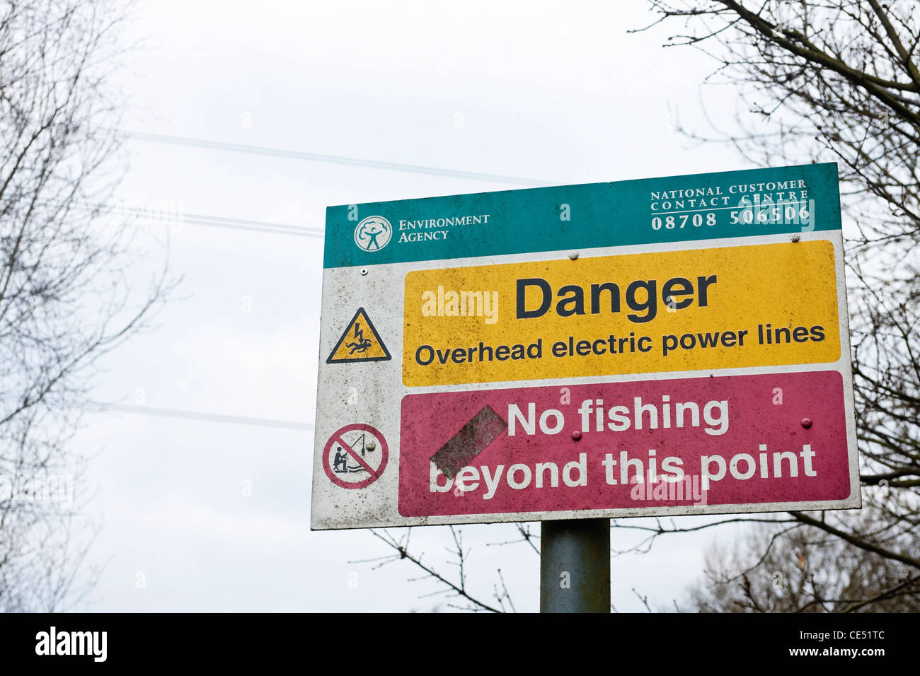 A sign telling fishermen not to fish due to the danger of overhead electric cables. - Stock Image