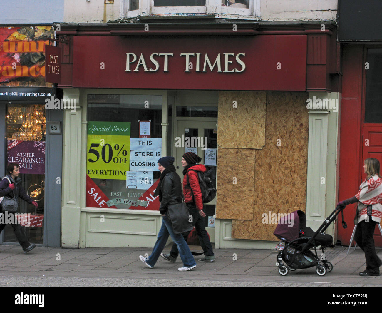 Past Times shop boarded up & closed due to going into administration - Stock Image