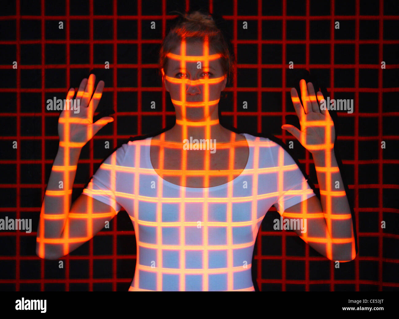 Biometric, symbol photo. Automatic face detection, by a laser scanner. 3D-model of a female face for generating - Stock Image