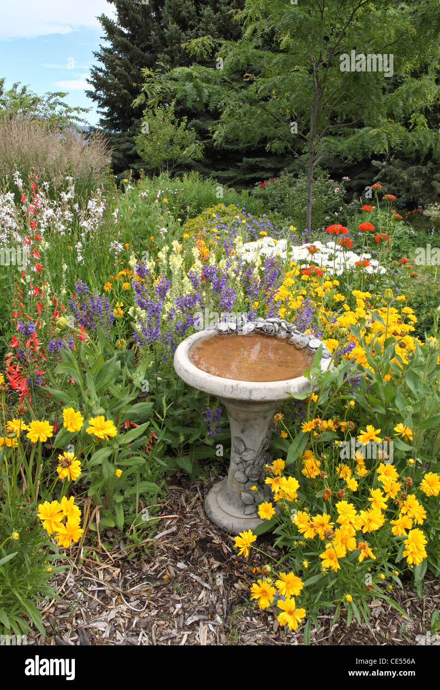 Attrayant Beautiful Flower Garden With Colorful Flowers And A Bird Bath