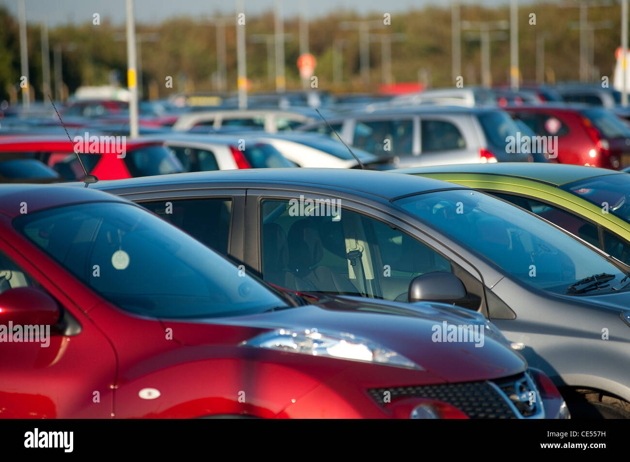 Vehicles parked in a very busy car park in England. - Stock Image
