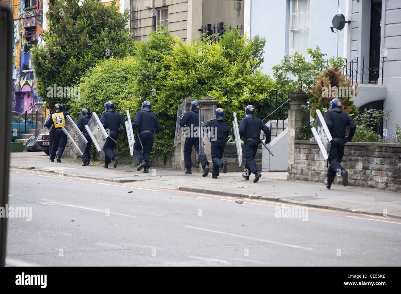 Riot Police charging a squat during a disturbance on Stokes Croft, Bristol, UK - EDITORIAL USE ONLY - Stock Image