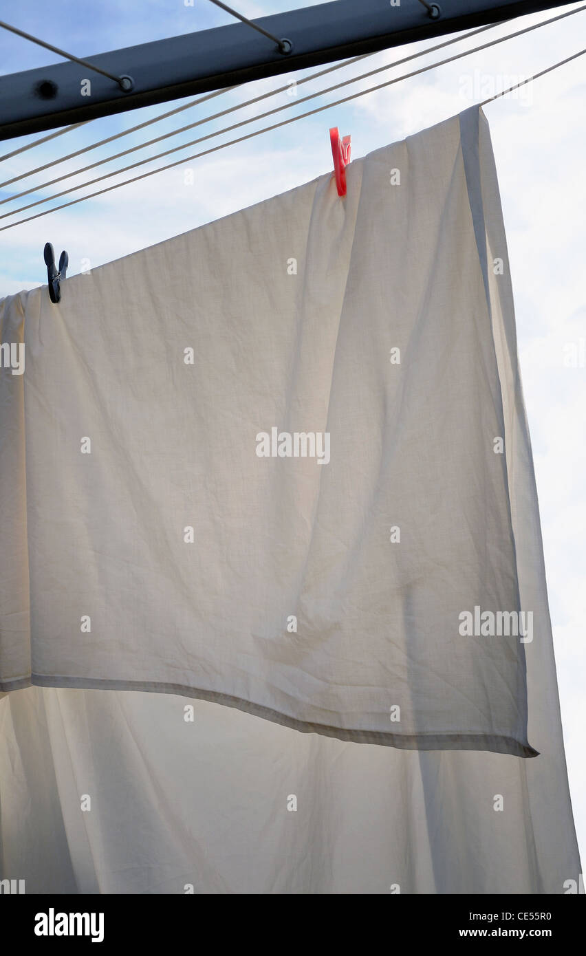 white sheet drying on rotary dryer - Stock Image