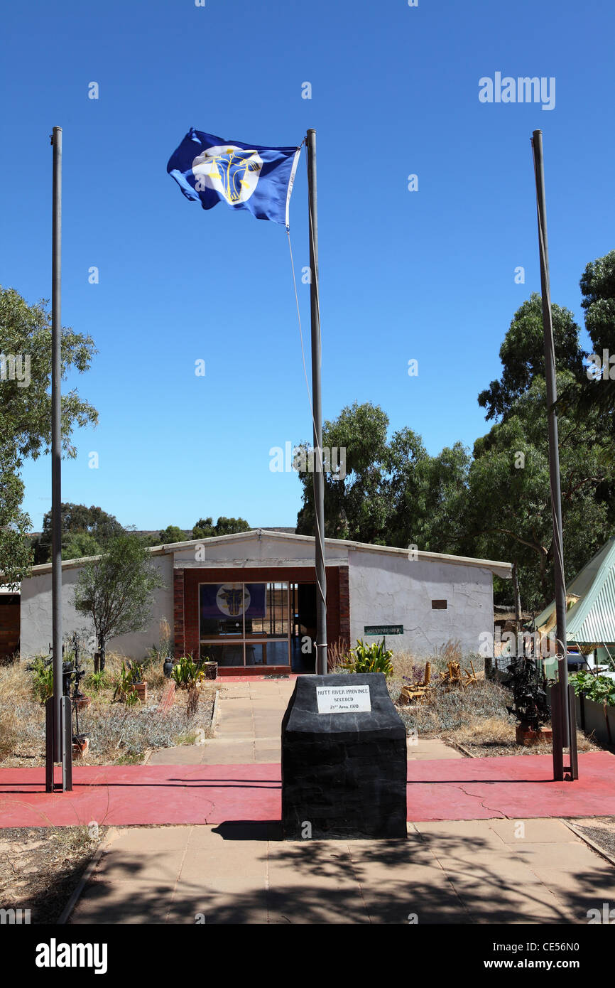 The flag of the Principality of Hutt River flies before the principality's souvenir shop. - Stock Image