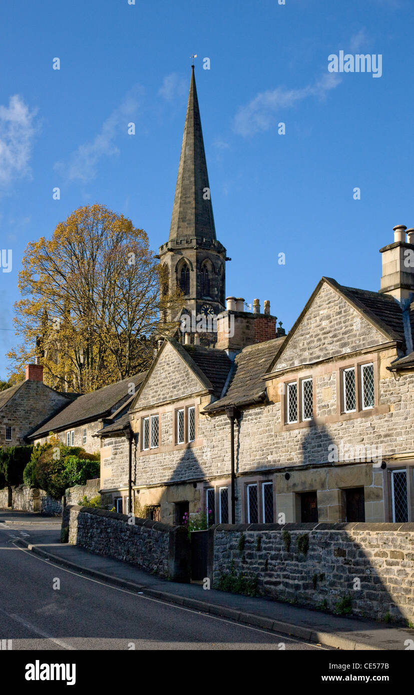 All Saints parish church and stone houses in King Street Bakewell Derbyshire UK - Stock Image