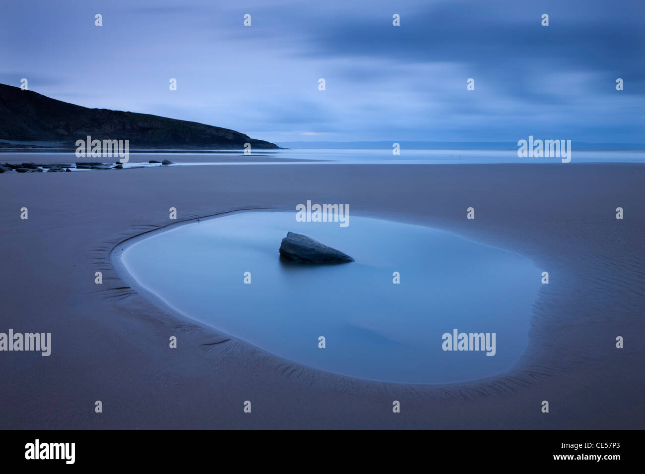 Rockpool on the sandy Southerndown beach at dawn, Dunraven Bay, Glamorgan Heritage Coast, Wales. Winter (December) - Stock Image
