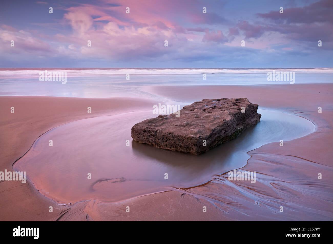 Pristine sandy beach at dawn, Southerndown, Glamorgan Heritage Coast, Wales, UK. Winter (December) 2011. - Stock Image