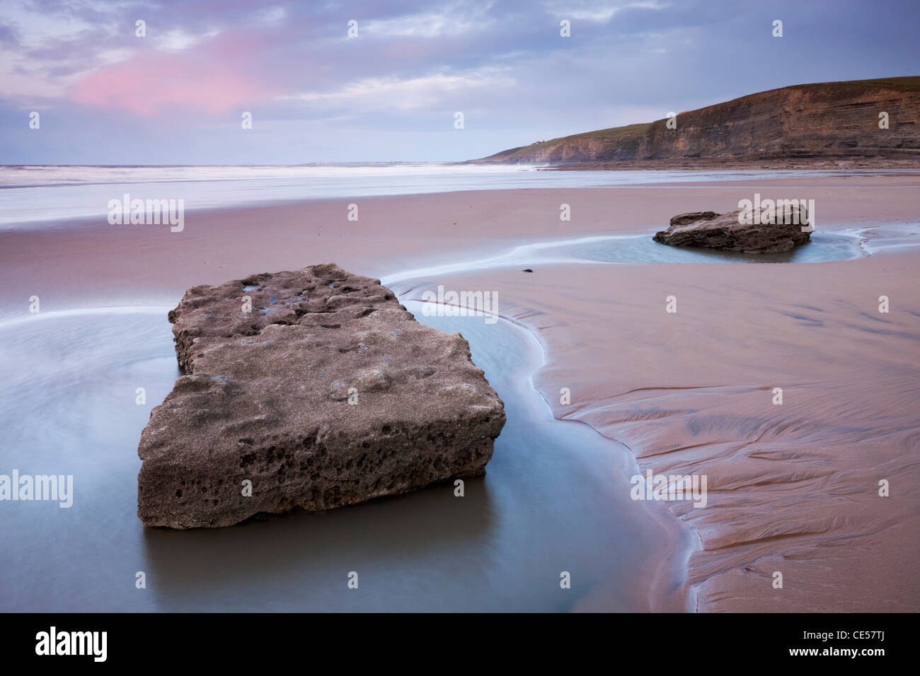 Rockpools on the sandy beach at Dunraven Bay, Southerndown, Glamorgan, Wales, UK. Winter (December) 2011. - Stock Image