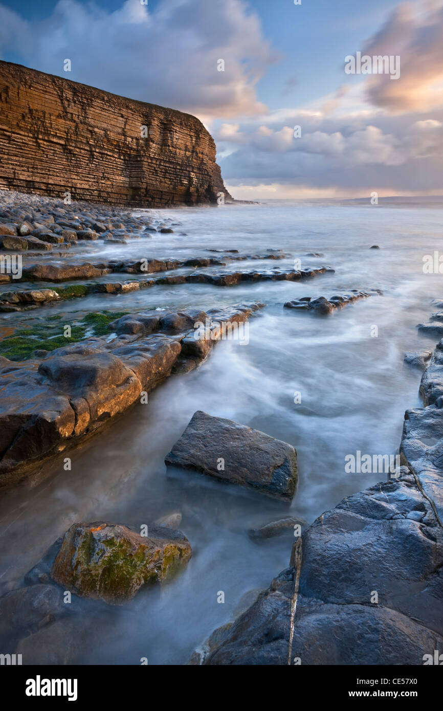 Rocky shore of Nash Point at sunset, Glamorgan Heritage Coast, Wales, UK. Winter (December) 2011. - Stock Image