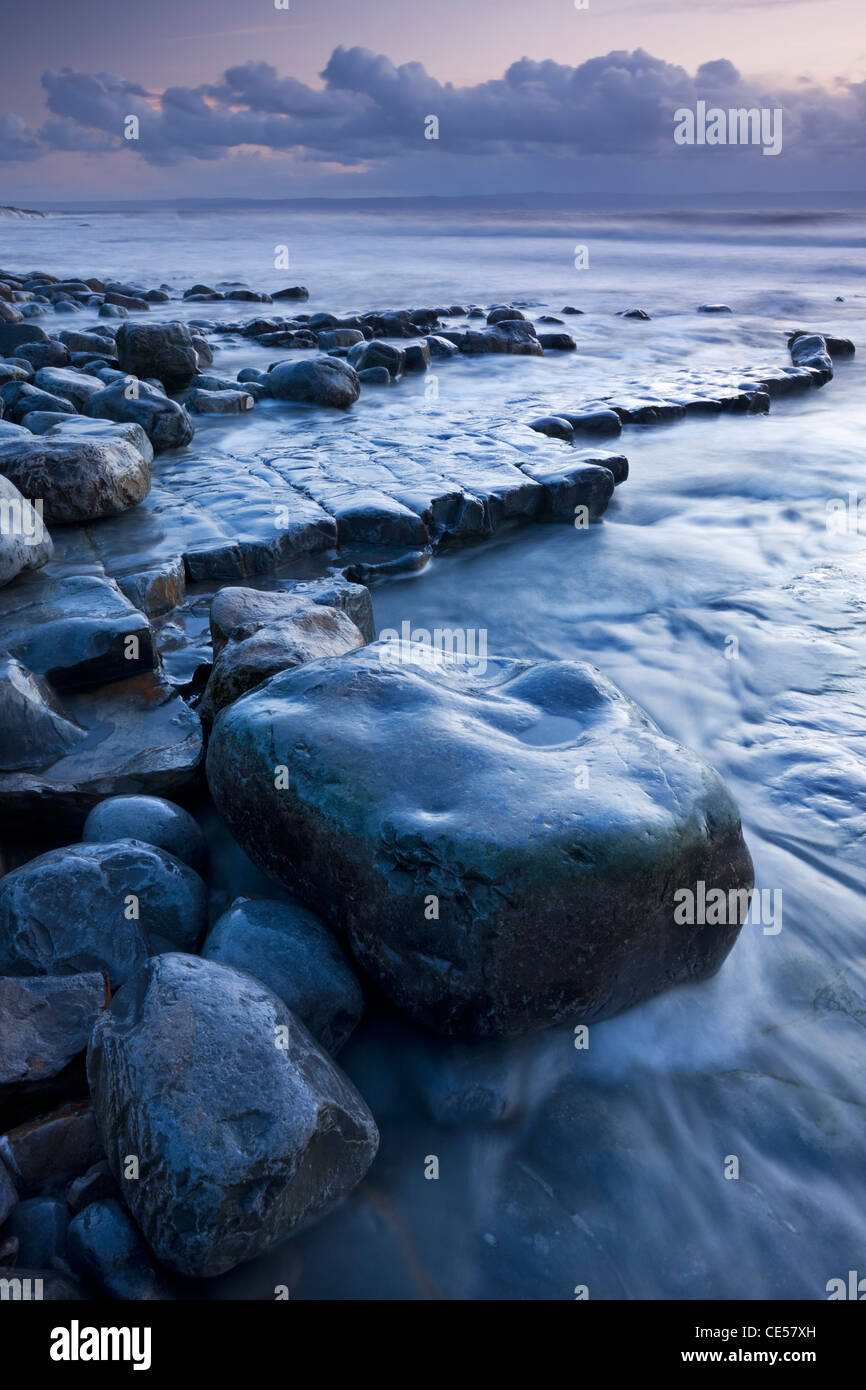 Rocky shore of Nash Point at twilight, Glamorgan Heritage Coast, Wales, UK. Winter (December) 2011. - Stock Image