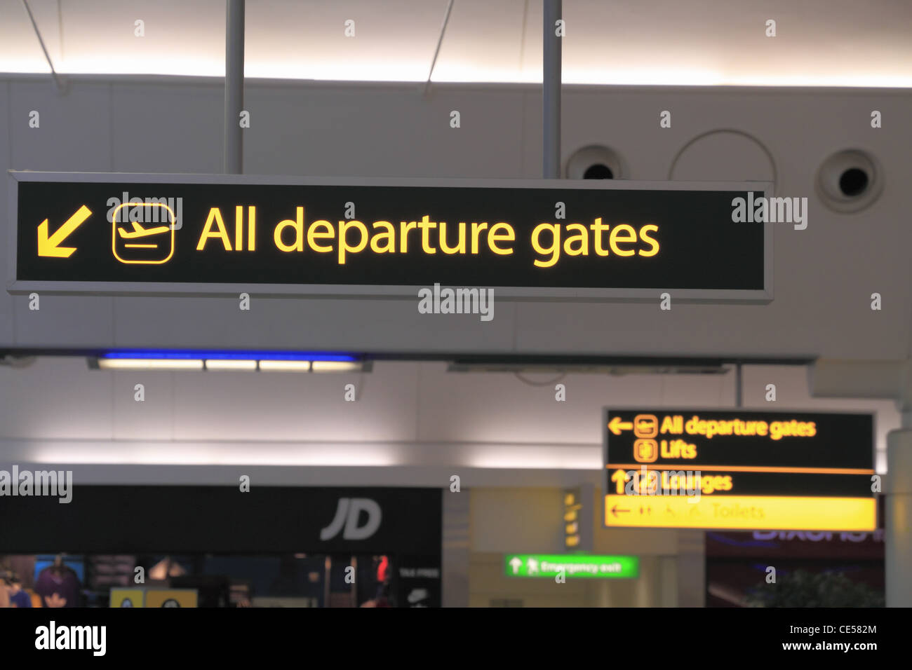 Flight departure gates public information sign in the South terminal of London Gatwick Airport, West Sussex, England. - Stock Image