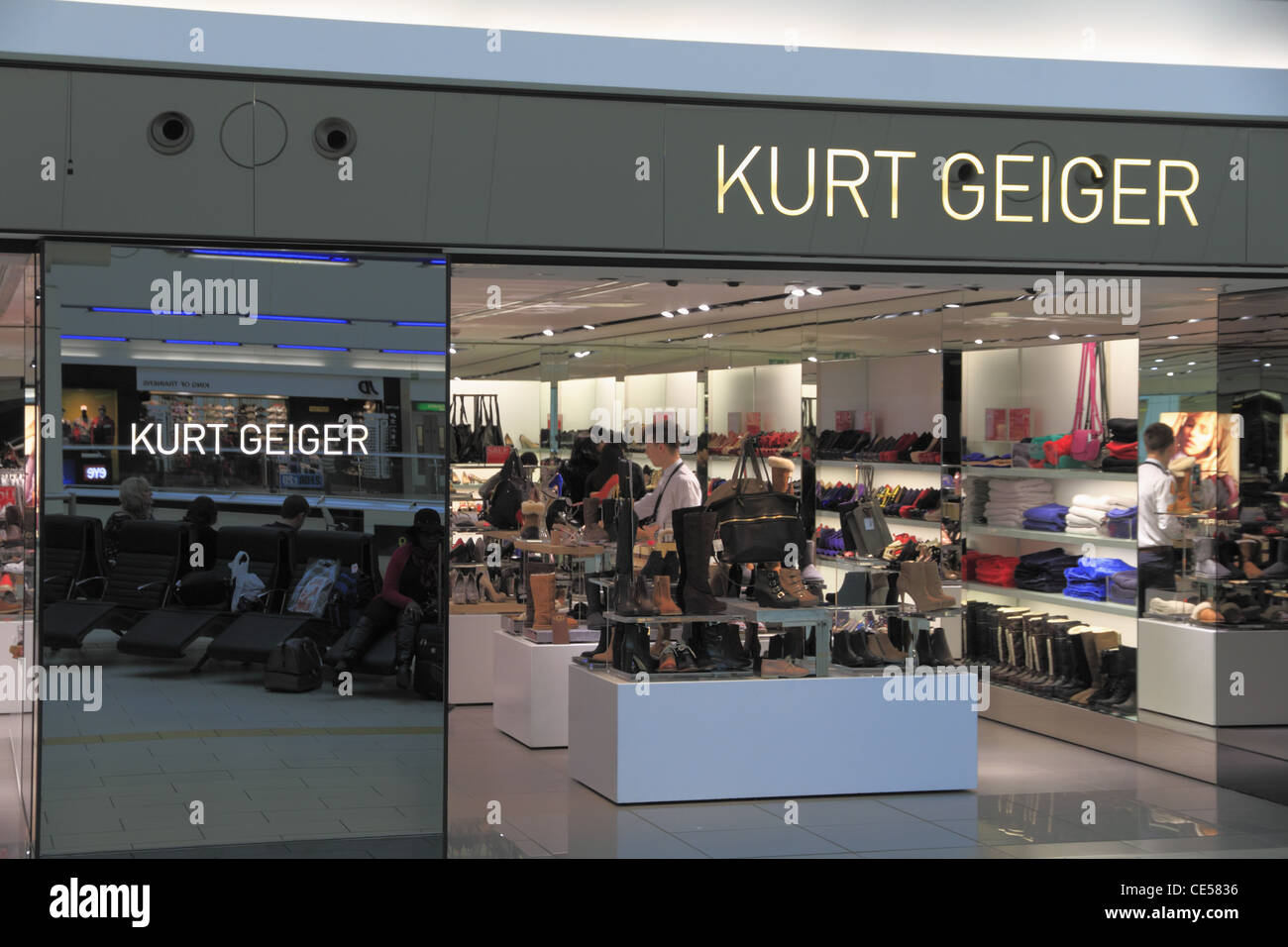628bd6eae Shoppers and travelers at the Kurt Geiger Fashion Footwear Shoes Boutique  shop store in Gatwick Airport, Sussex, England.
