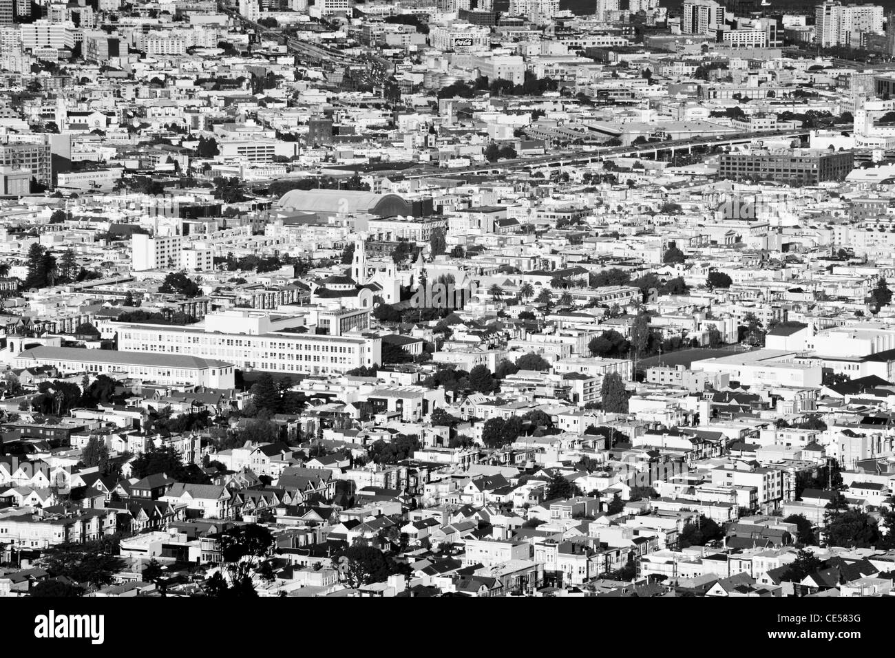 black and white photograph of San Francisco outskirts, showing the tightly-packed urban sprawl of buildings, streets - Stock Image