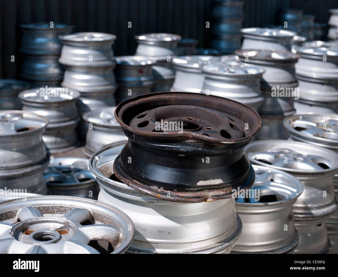 crash damaged steel car wheel rim - Stock Image