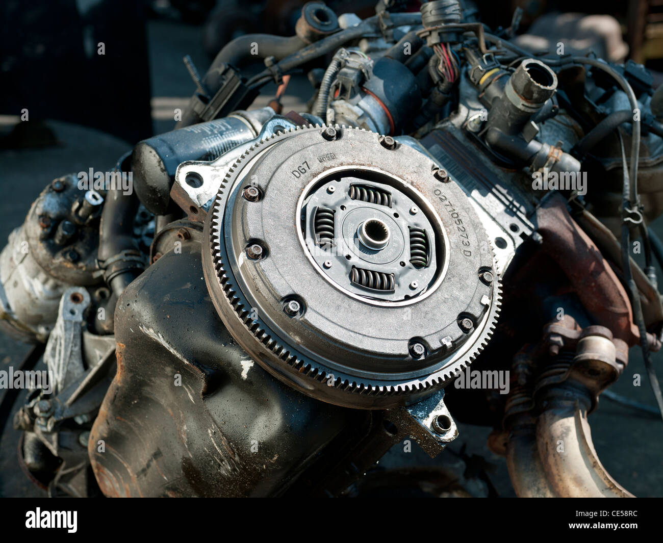 car scrapyard & close up of clutch plate - Stock Image