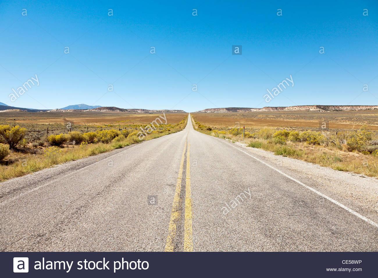 Long desert road, Utah Highway 211, near Canyonlands National Park, Colorado, United States - Stock Image