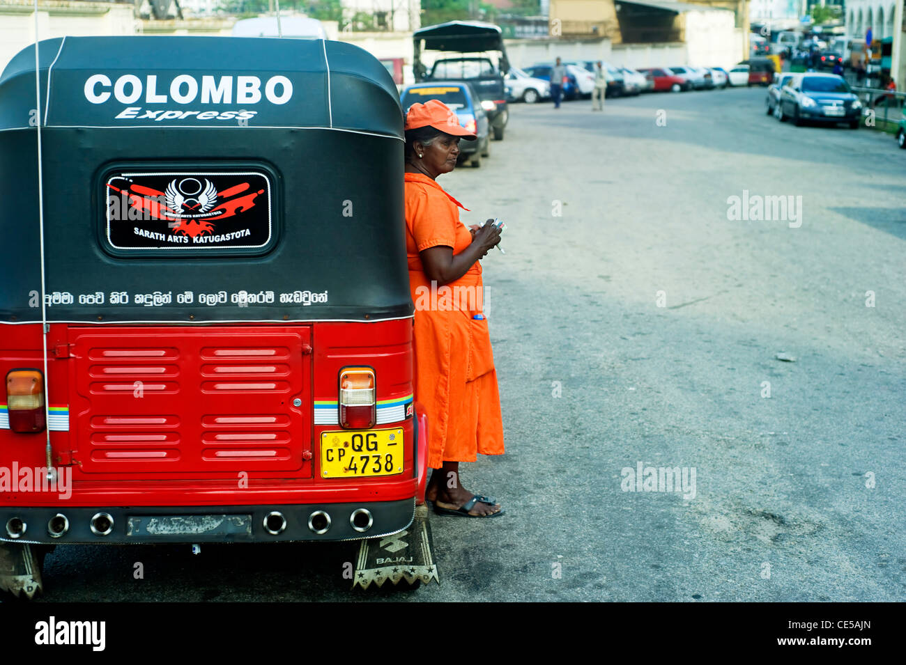 Worker of Sri Lankan traditional taxi(tuk-tuk) waiting for clients. - Stock Image