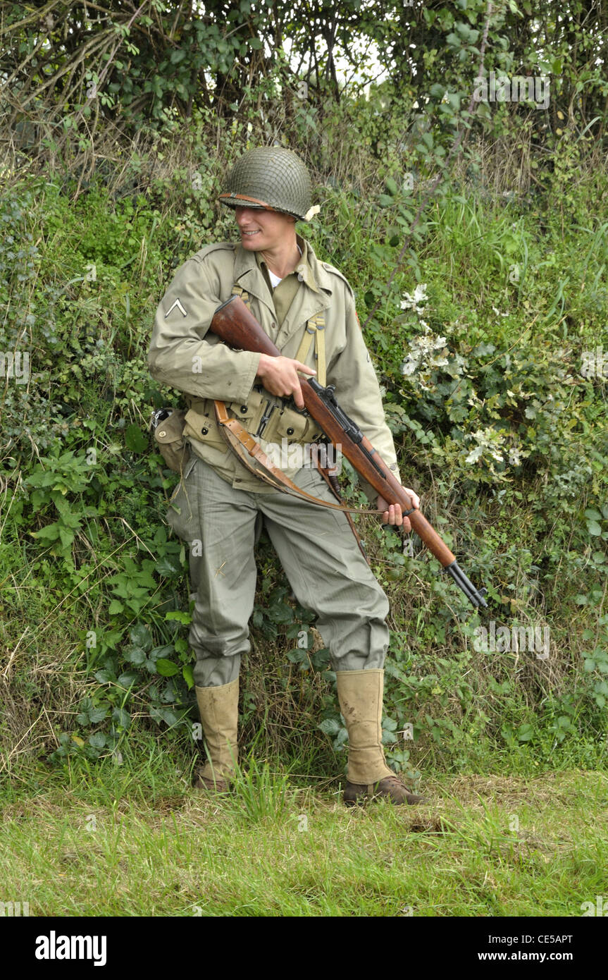 Scene reconstruction, US army soldier, liberation of the town of Oisseau (Mayenne, France), during World War II. - Stock Image