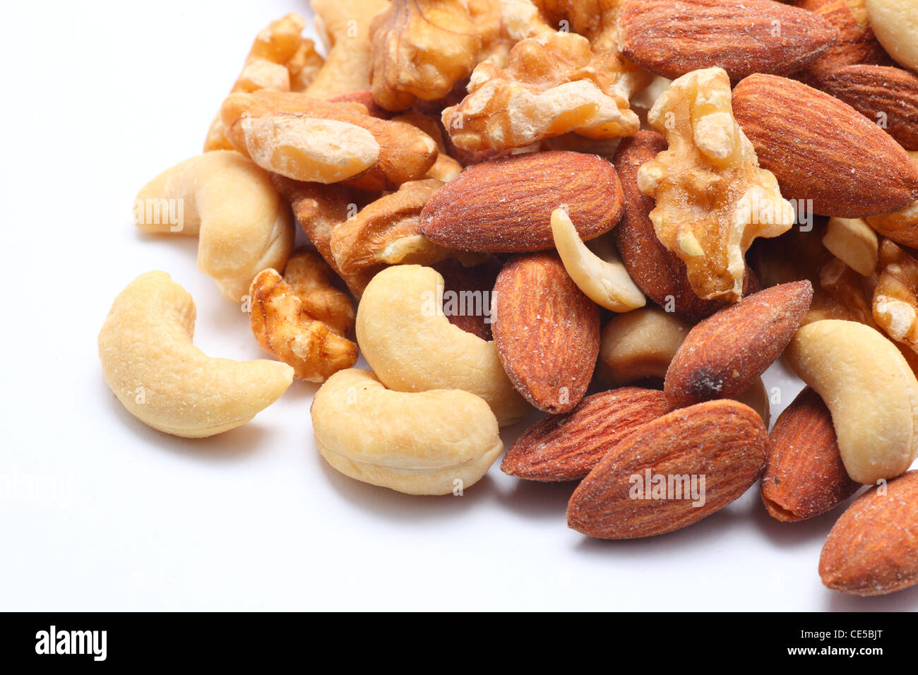 Mixed nuts on white background - Stock Image