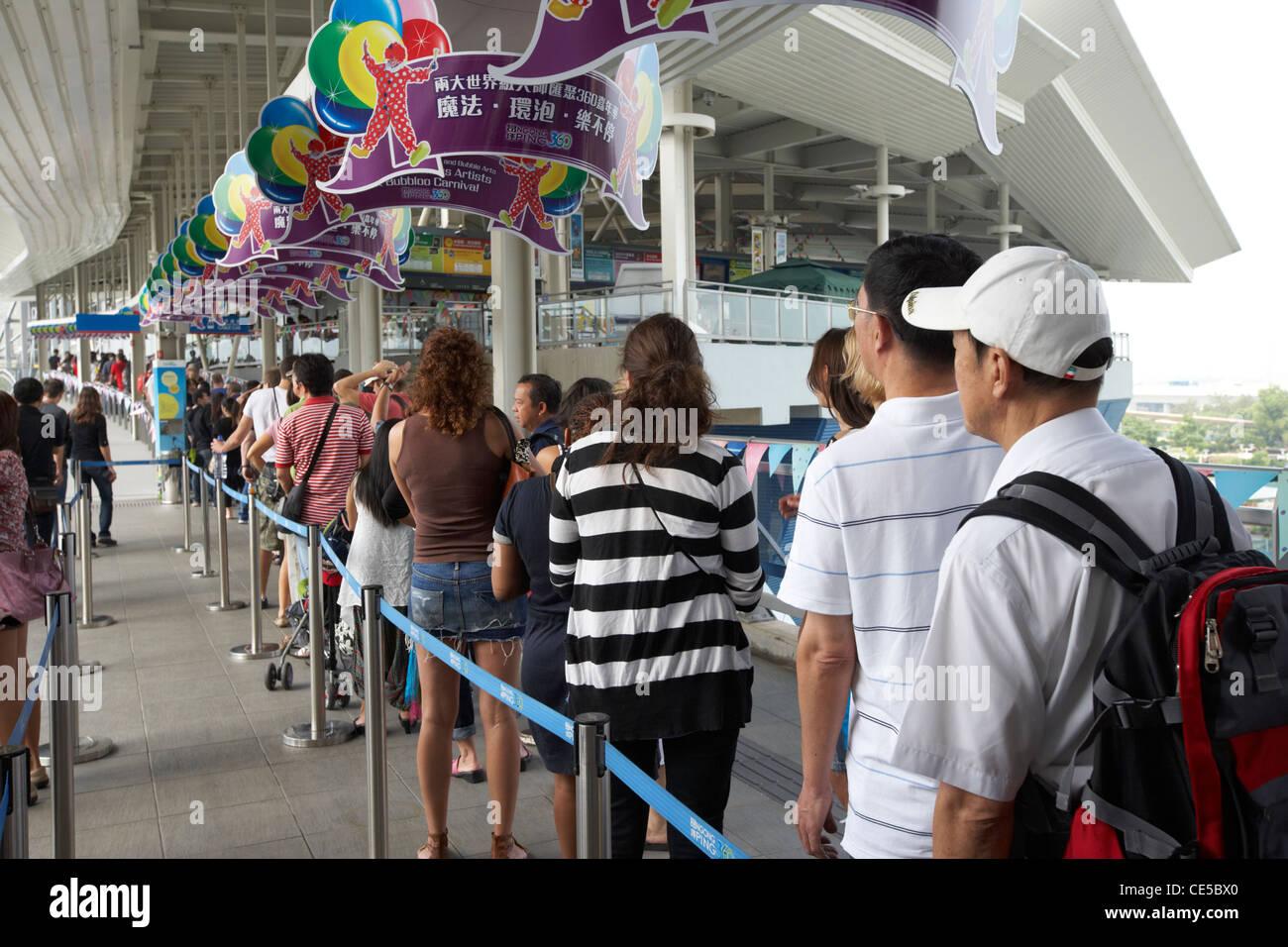 people queuing at the entrance to the ngong ping 360 cable car tung chung lantau island hong kong hksar china asia - Stock Image