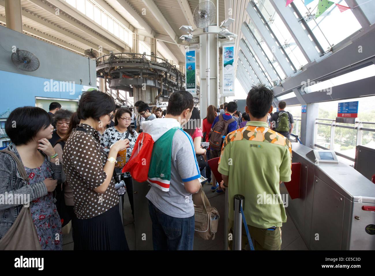 people queuing inside the ngong ping 360 cable car tung chung lantau island hong kong hksar china asia - Stock Image