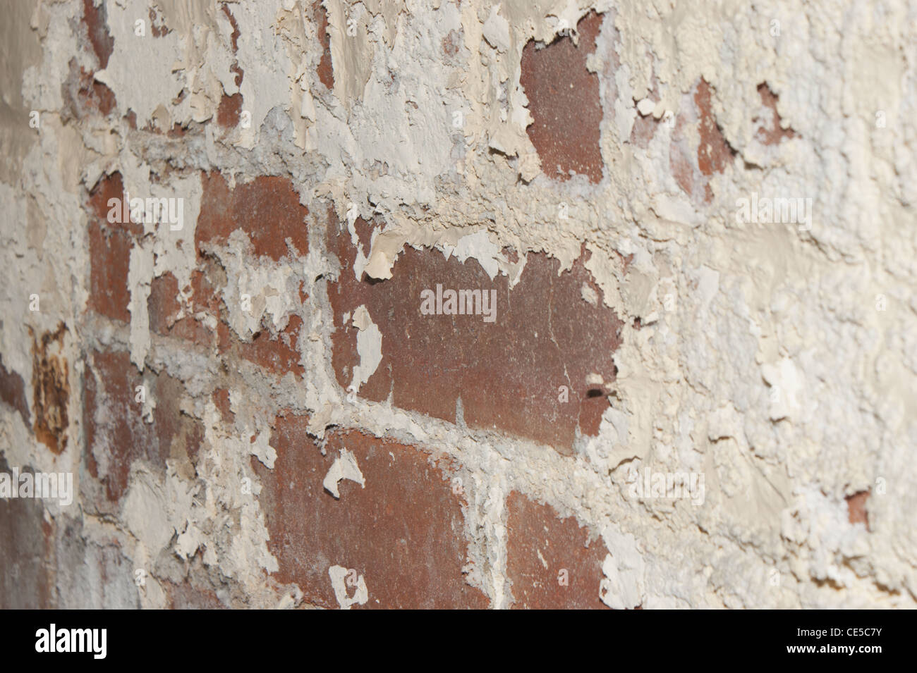 Damp wall paint flacking off Stock Photo
