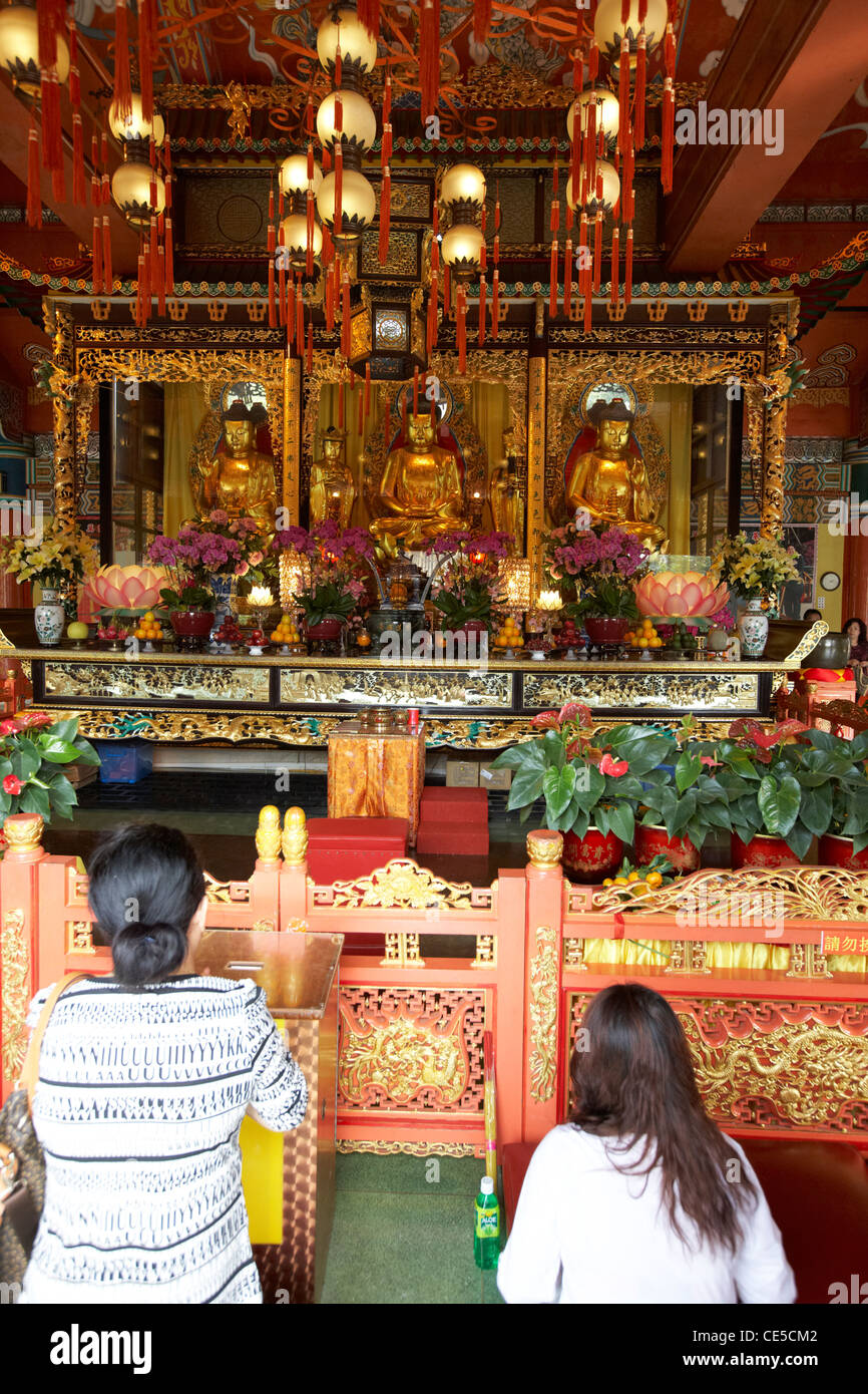 chinese women praying at po lin monastery ngong ping lantau island hong kong hksar china asia - Stock Image