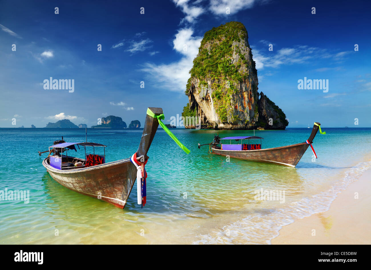 Tropical beach, longtail boats, Andaman Sea, Thailand - Stock Image