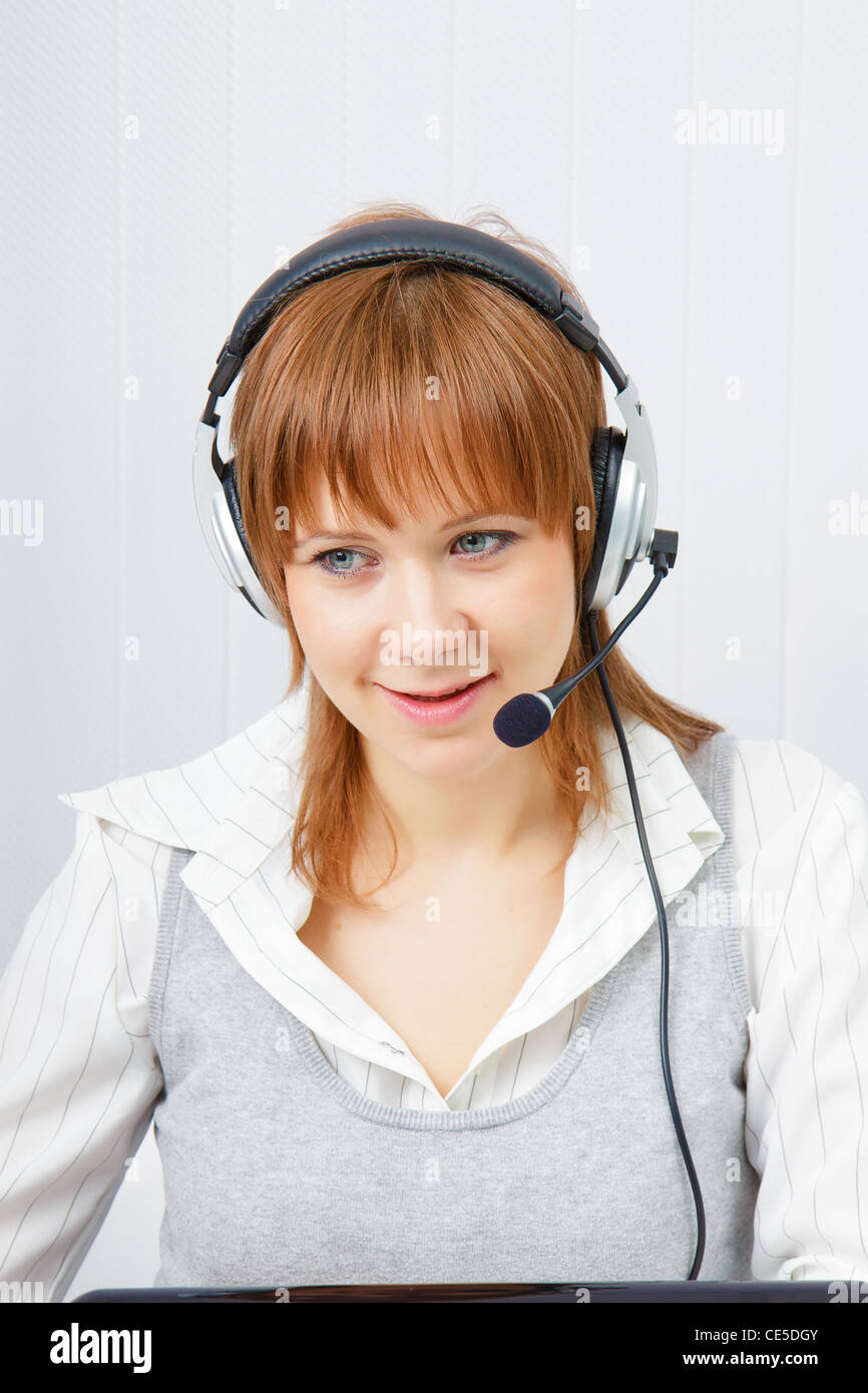 girl in headphones with a microphone. HotLine Stock Photo