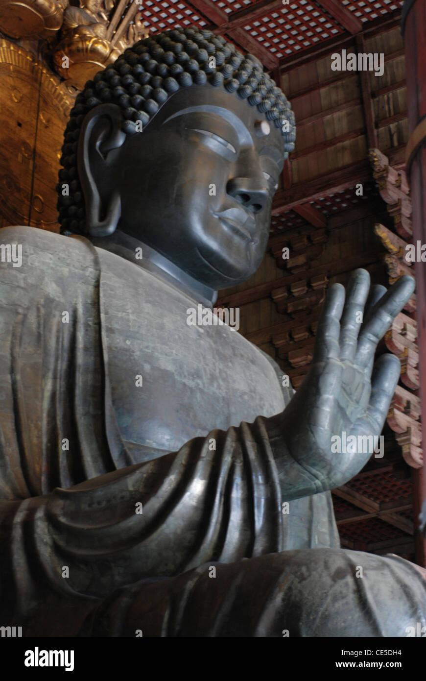 Daibutsu (Rusyana Butuzou), the biggest wooden Buddha in Japan sitting inside Todaiji temple, Nara, Japan. UNESCO - Stock Image