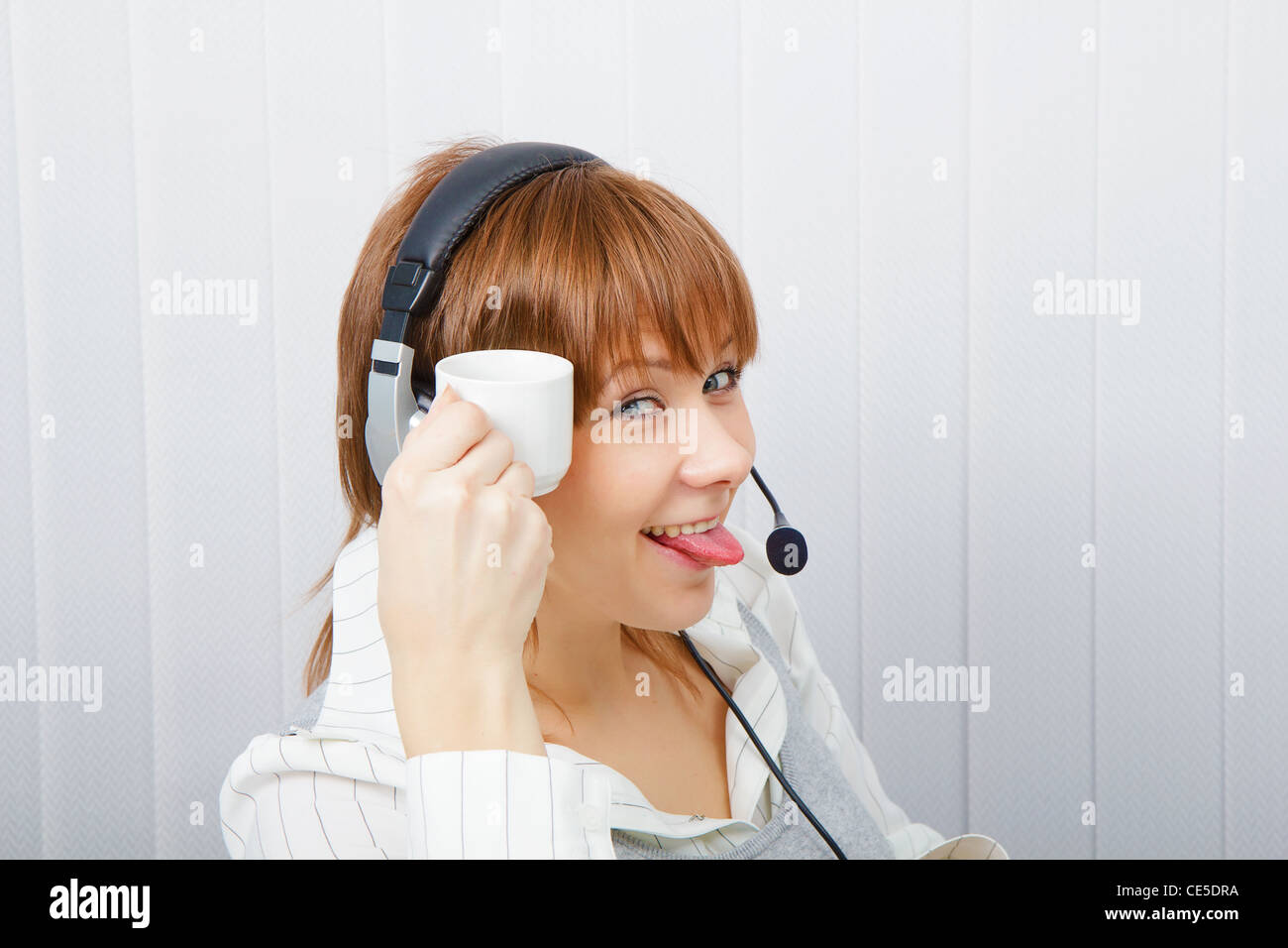 Operator on-line service. Girl in a playful mood Stock Photo
