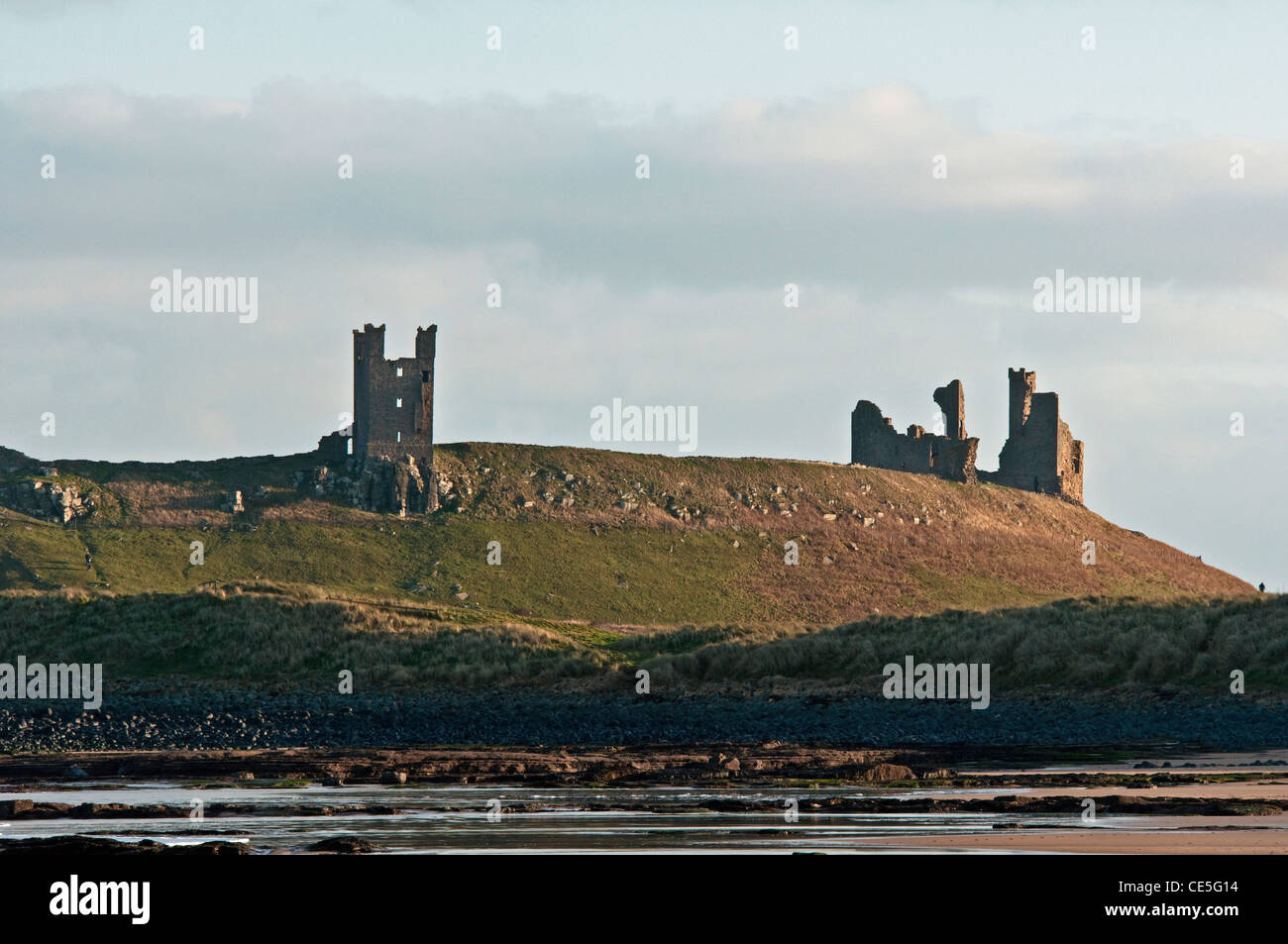 Dunstanburgh Castle photographed from Embleton Bay on the Northumberland Coast - Stock Image