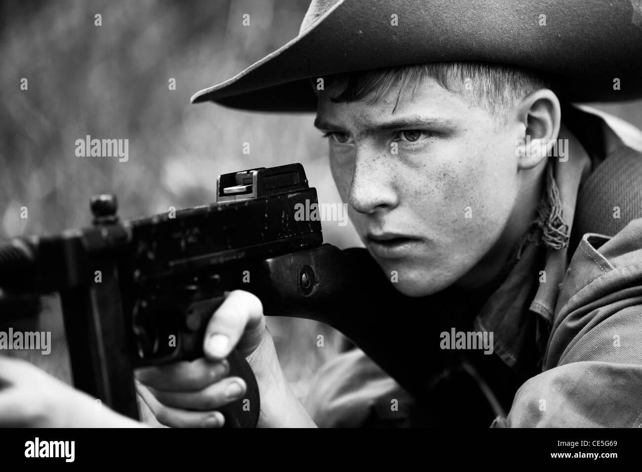 WW2 Re-Enactors - British Soldier with Thomson Machine Gun - Stock Image