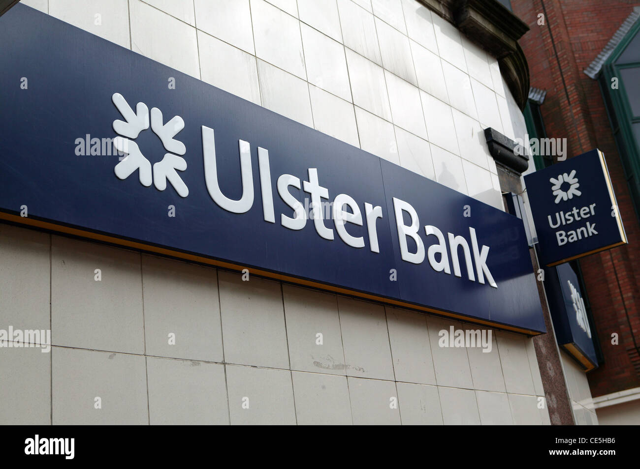 Ulster Bank Sign, Royal Bank of Scotland Logo, Navy blue and white corporate sign. On Cream tiles - Stock Image