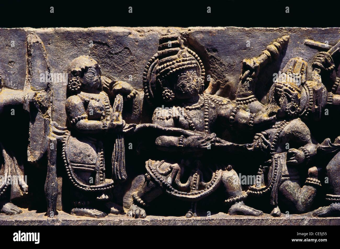 Dushyasana Vatha Bhima killing Dushyasana Mahabharata scene ; Hoysaleswara temple at Halebid ; Karnataka ; India - Stock Image