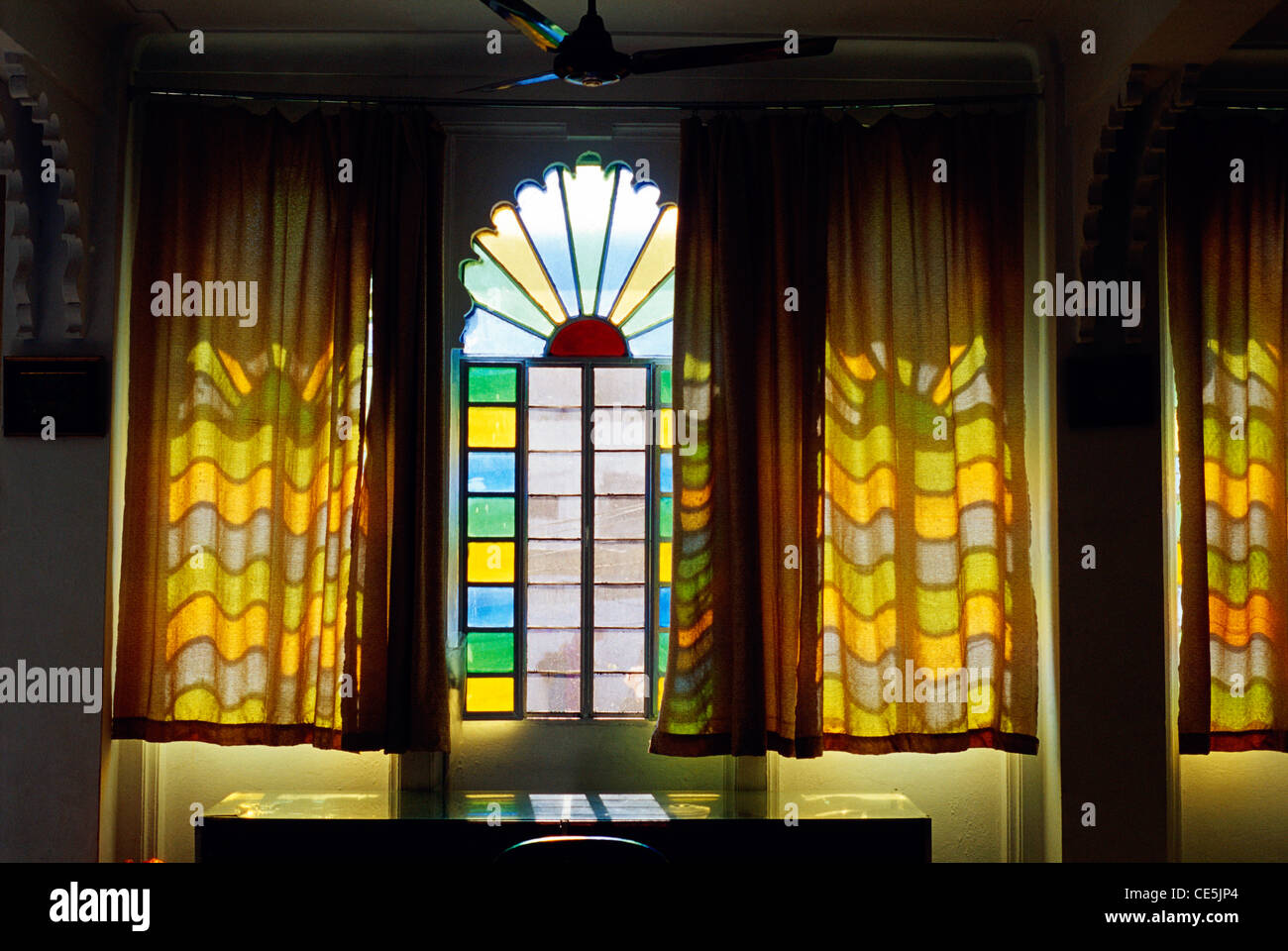 e2b8b4b7b194 Stained Glass window through curtains   Udaipur   Rajasthan   India - Stock  Image