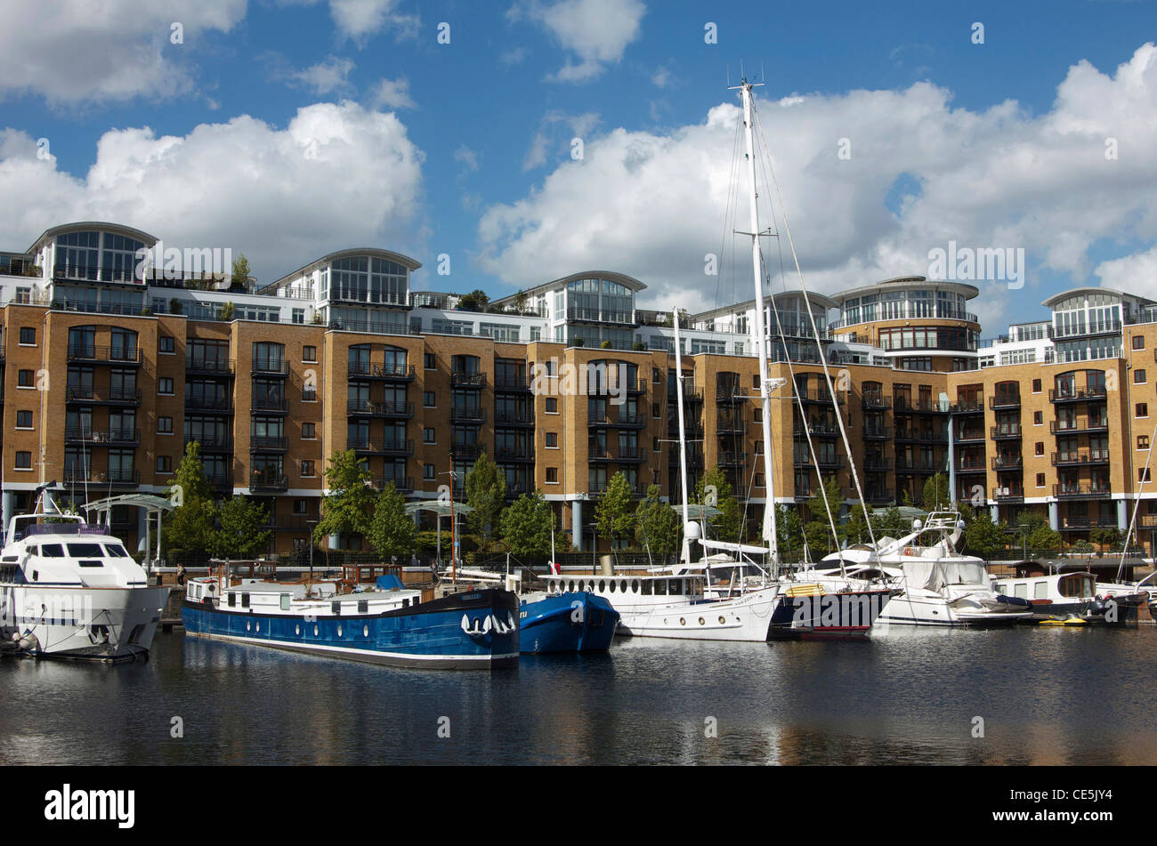 Yachts and barges in St. Katharine's Dock, London, England - Stock Image