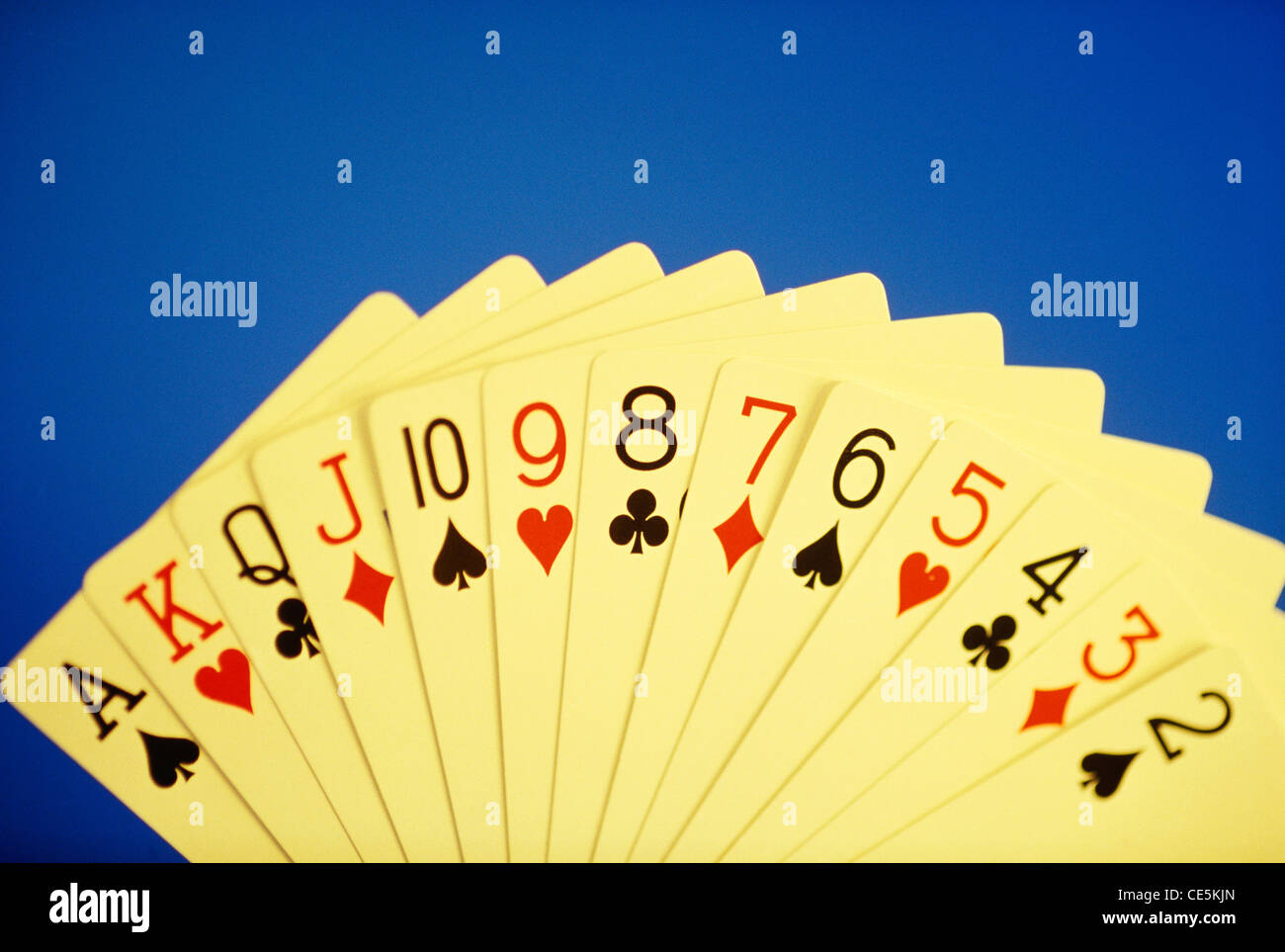 playing cards on blue background full hand 2 3 4 5 6 7 8 9 10 jack queen king ace - Stock Image