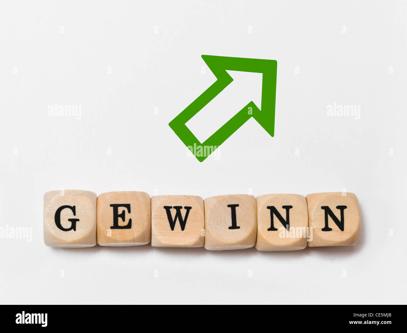 a green arrow upside, alongside are cubes which form the word 'profit' in German - Stock Image