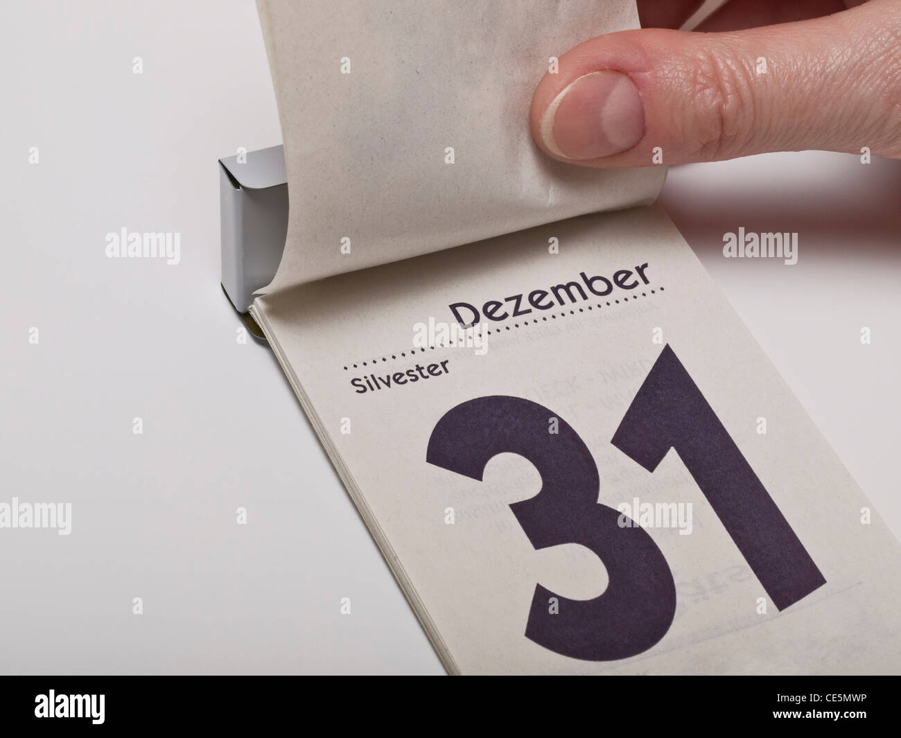 A calendar sheet is lifting and shows December 31st, New Year's Eve Stock Photo