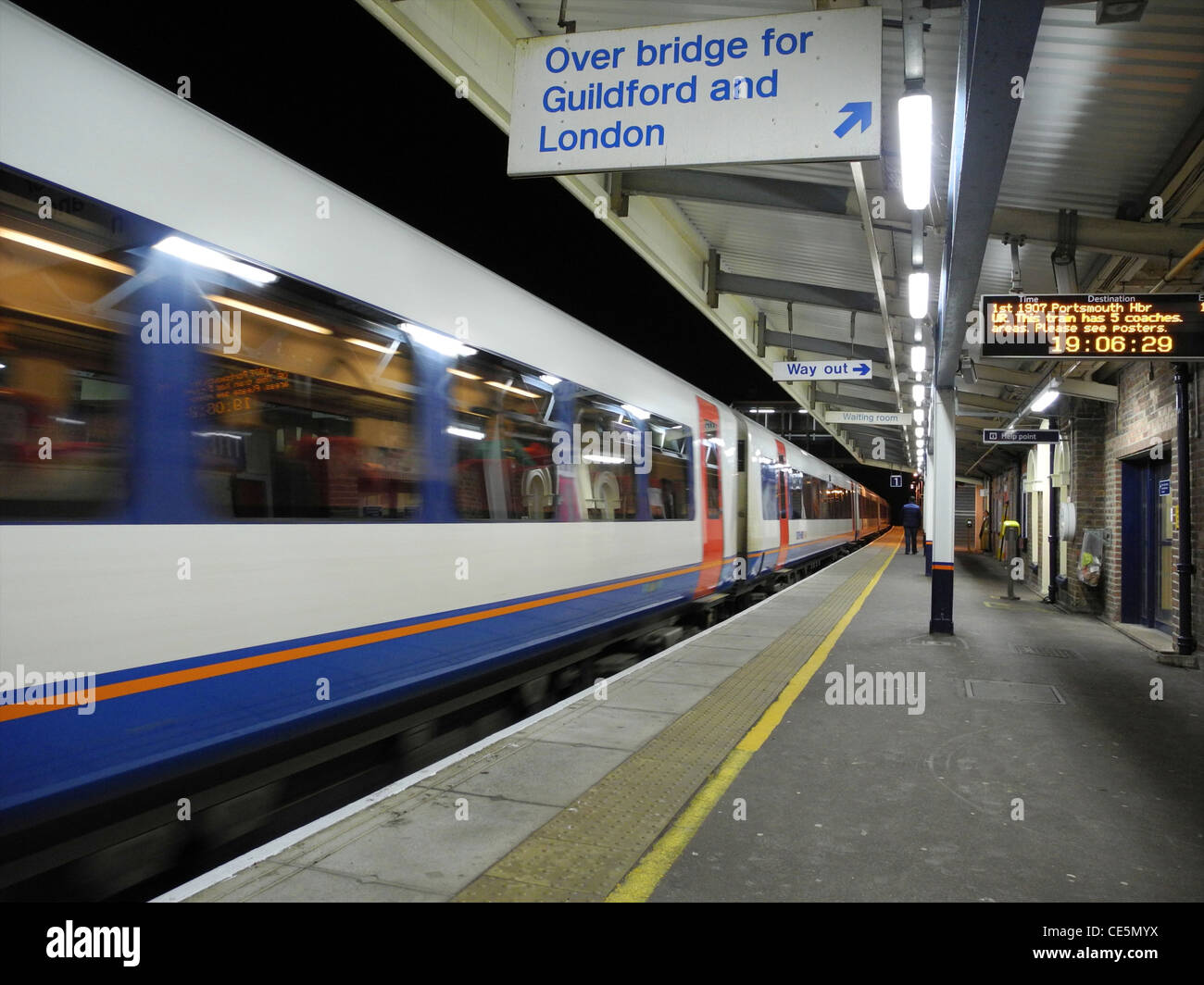 Passengers arriving on UK railway platform station EDITORIAL USE ONLY - Stock Image
