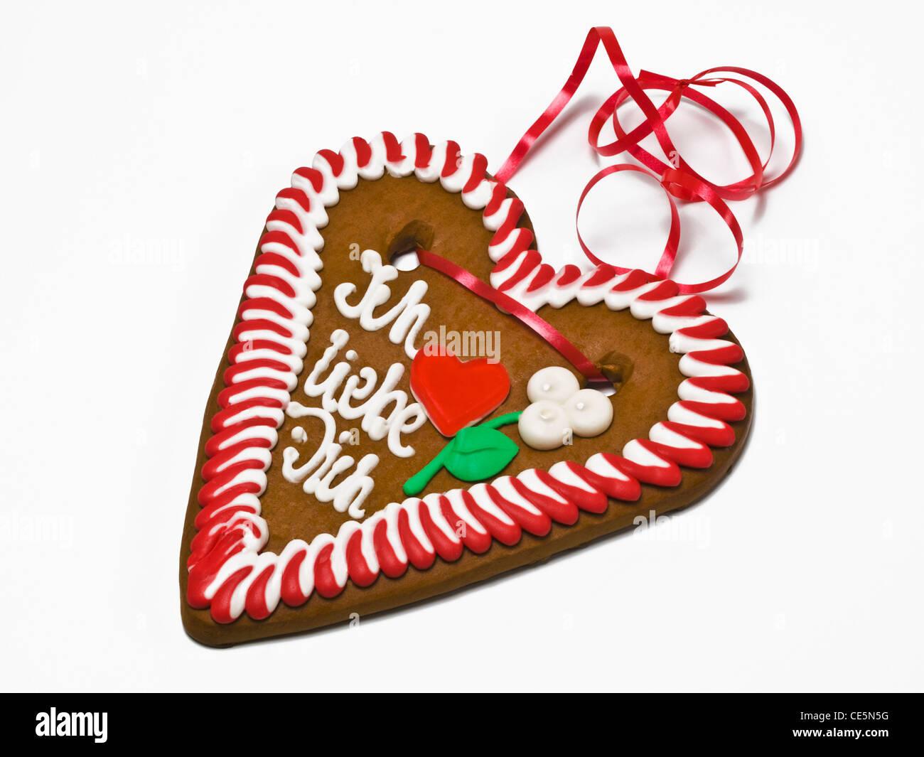 ein Pfefferkuchenherz mit der Aufschrift Ich liebe Dich | a gingerbread heart with the inscription I love you in - Stock Image