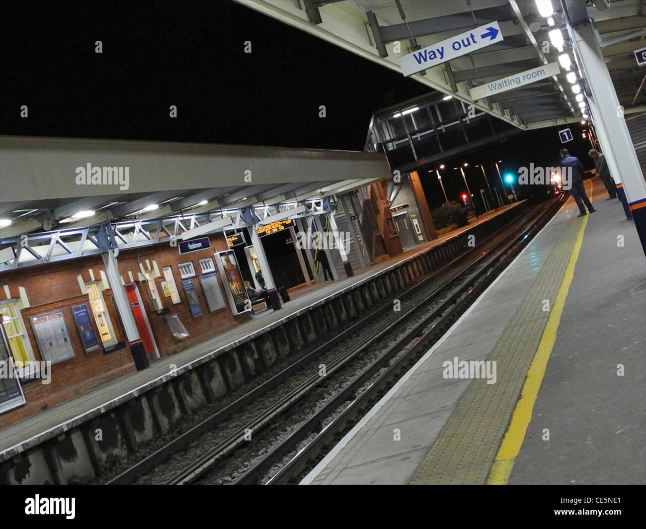Passengers arriving on UK railway platform station EDITORIAL USE ONLY - Stock Image