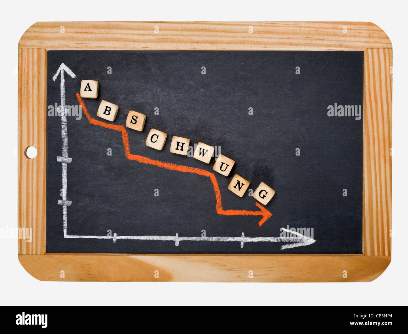 Detail photo of a slate, a chart with an declined curve on this, alongside are cubes that form the word 'Downturn' - Stock Image