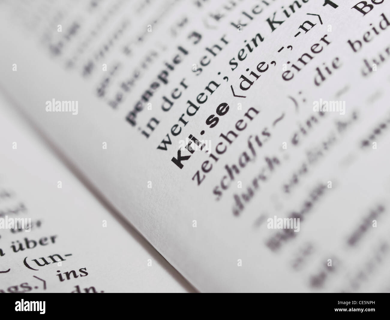 Deutsches Wörterbuches mit dem Begriff 'Krise' | German dictionary with the item 'crisis' in - Stock Image