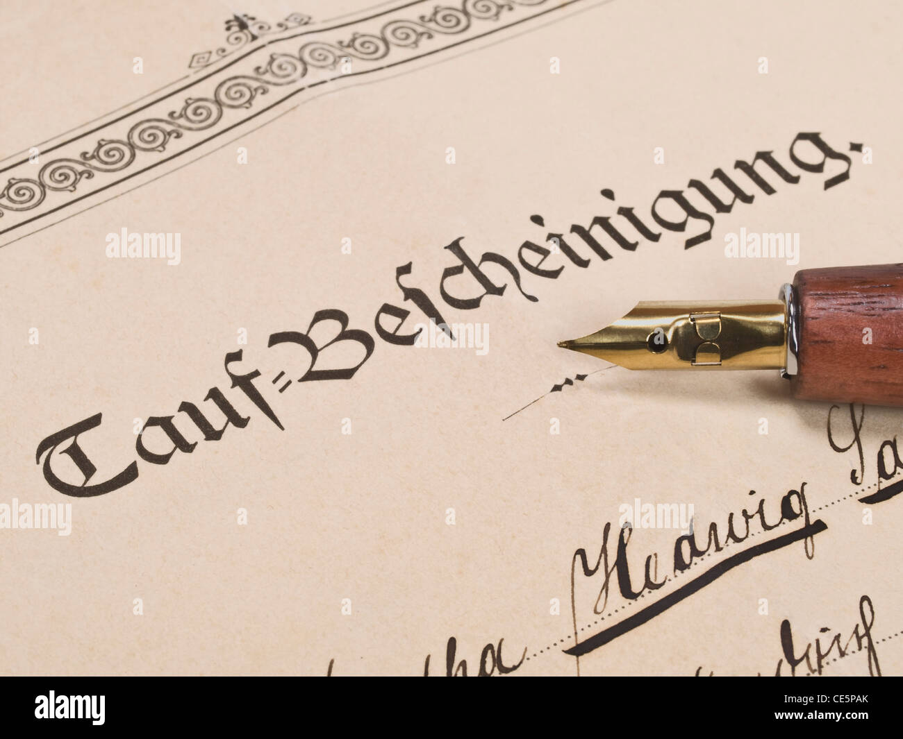 Detail photo of a christening attestation from the year 1890, on it is a pen - Stock Image