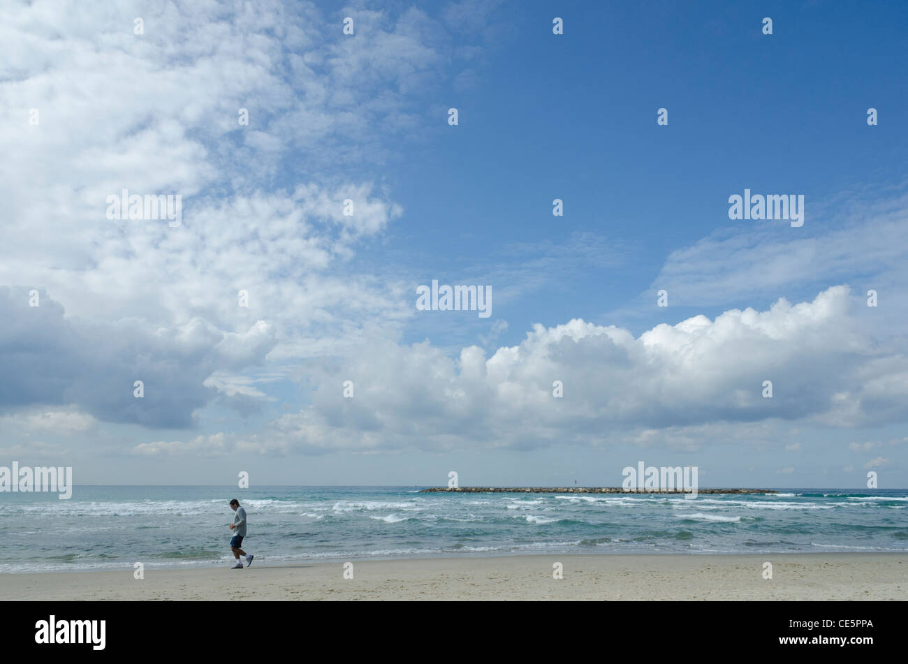 man jogging on the beach. jerusalem beach. Tel Aviv. israel - Stock Image