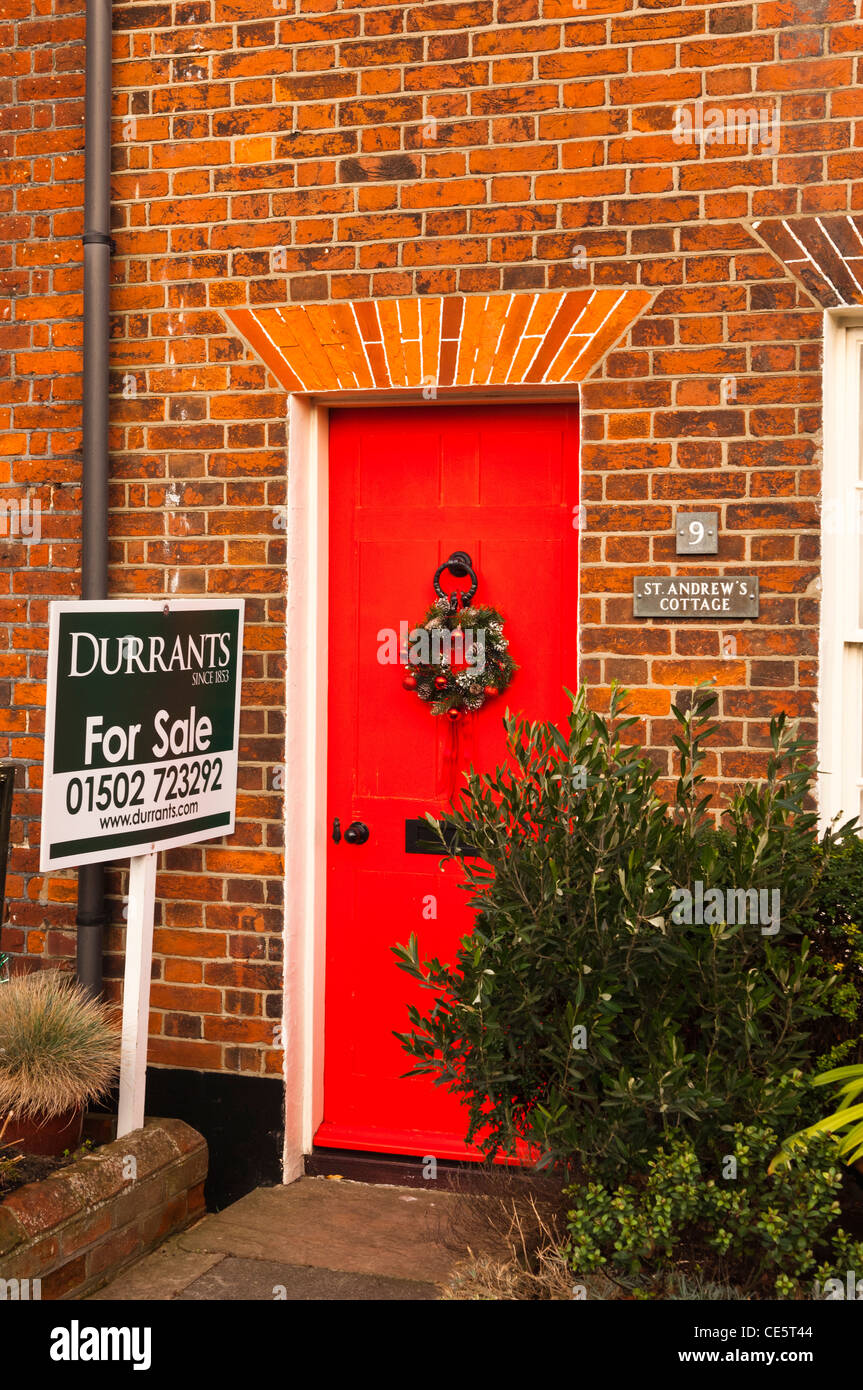 A pretty red brick cottage for sale at Southwold , Suffolk , England , Britain , Uk - Stock Image