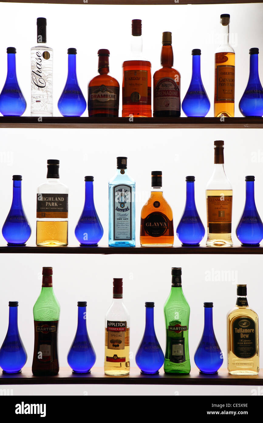 Bottles of spirits in a bar window display. - Stock Image
