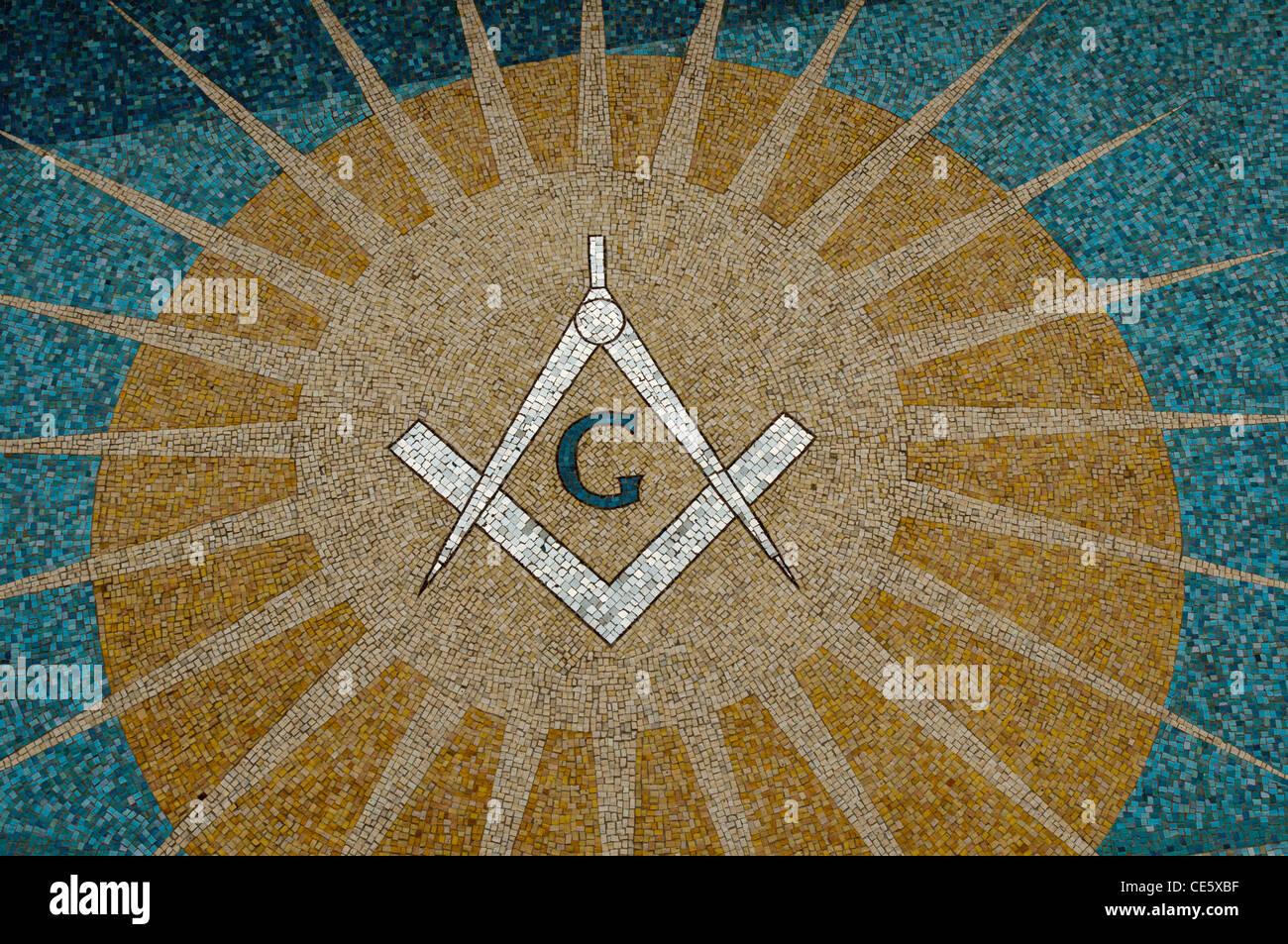 Square and Compasses and sun mosaic on the wall of Grand Lodge of Massachusetts, Boston, United States, USA, freemasonry - Stock Image